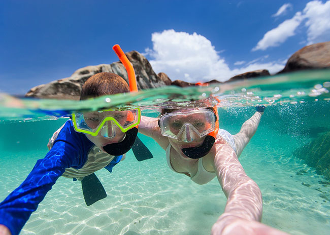 Desiree and her brother snorkeling in the beach.