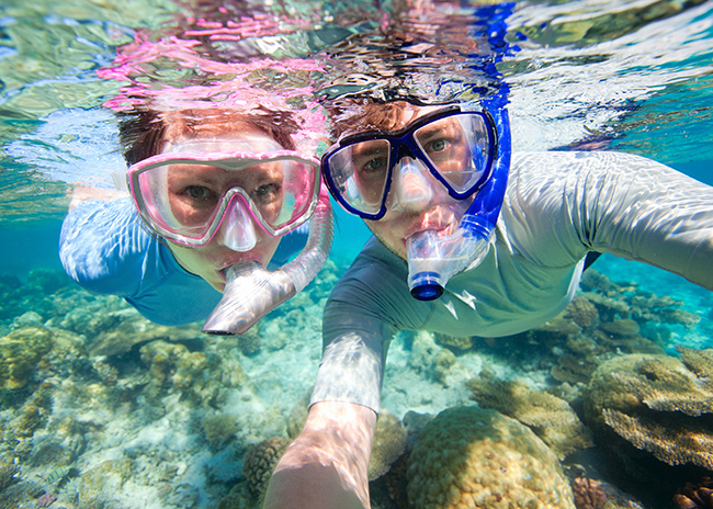 Bruce and his sister having a good time in the shallow waters of Cozumel.