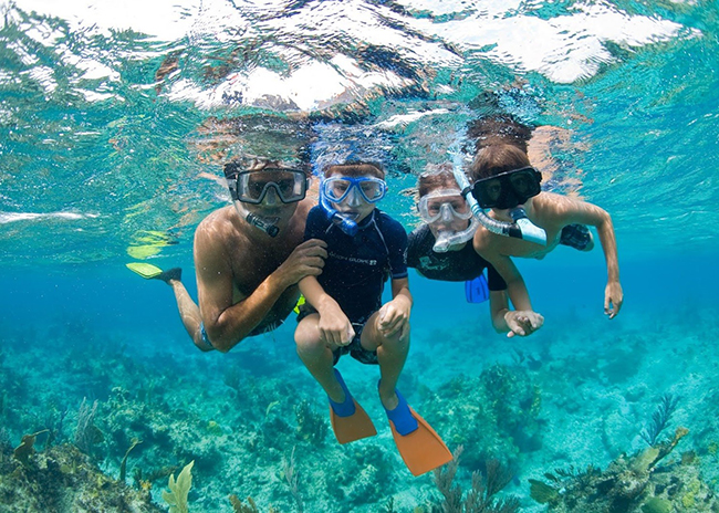 Thomas and his kids enjoying a snorkeling tour in Cozumel.